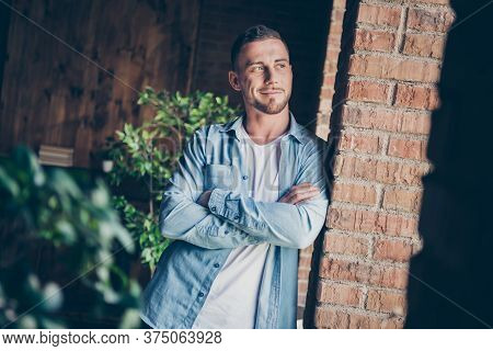 Photo Of Handsome Homey Guy Leaning Brick Design Wall Look Window Dreamy Imagination Flight Want Go