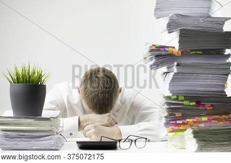 Overworked Young Businessman In Glass And Tie Laid His Head Down On Desk Depressed In Business Stres
