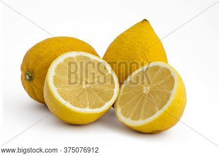 Composition Of Fresh Ripe Lemons, Delicious Citrus Fruit With Green Leaves Isolated On White Backgro