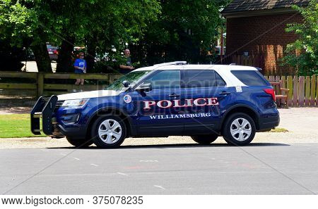 Williamsburg, Virginia, U.s.a - June 30, 2020 - The Blue Police Car On The Street