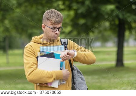 Stressed Anxious Young Guy Is Late, Busy University Or College Student Or Pupil With Books, Textbook