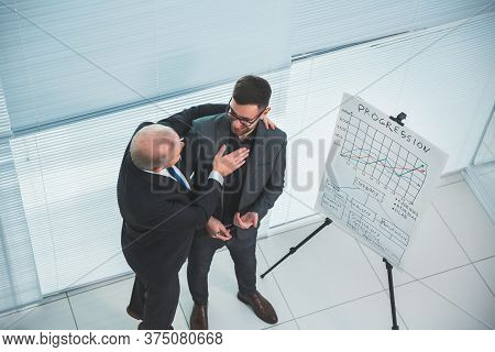 Project Manager Congratulating The Employee On A Successful Presentation