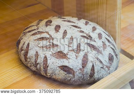 Live Sourdough Bread With A Pattern Of Bran. Photo Of Healthy Food