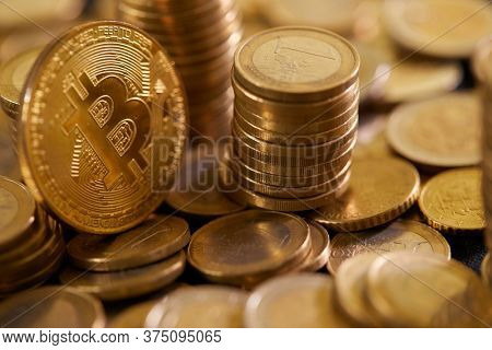 Stock Photo - Euro coins. Euro money. Euro currency.Coins stacked on each other in different positions. Money concept