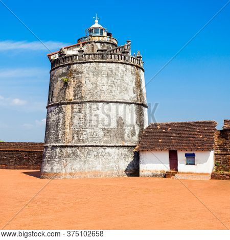 Fort Aguada And Its Lighthouse Is A Portuguese Fort Standing On Sinquerim Beach In Goa, India