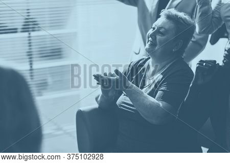 Close Up. Smiling Business Woman Applauding At An Office Meeting