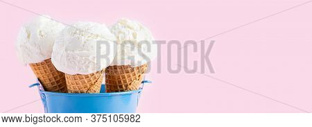 Ice Cream Cones In A Blue Bucket On A Pink Background. A Wafer-style Ice Cream Cone. Web Banner