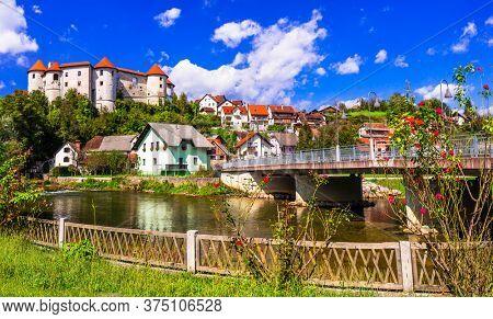 Slovenia landmarks and travel - medieval castle and village Zuzemberk over Krka river