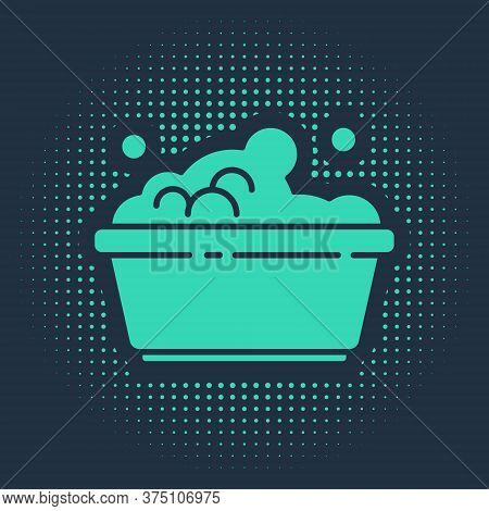 Green Plastic Basin With Soap Suds Icon Isolated On Blue Background. Bowl With Water. Washing Clothe
