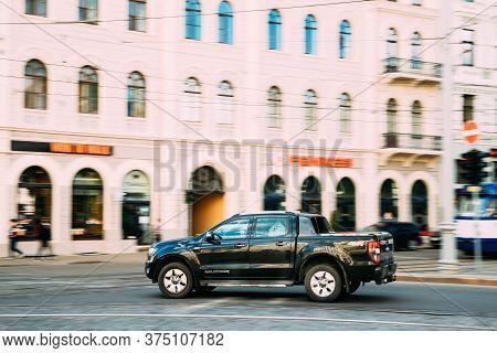 Riga, Latvia - June 9, 2019: Black Ford Ranger Wildtrak Fast Drive In Summer City Street. The Third-