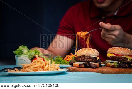 Man Holding Hamburger On The Wooden Plate After Delivery Man Delivers Foods At Home. Concept Of Bing