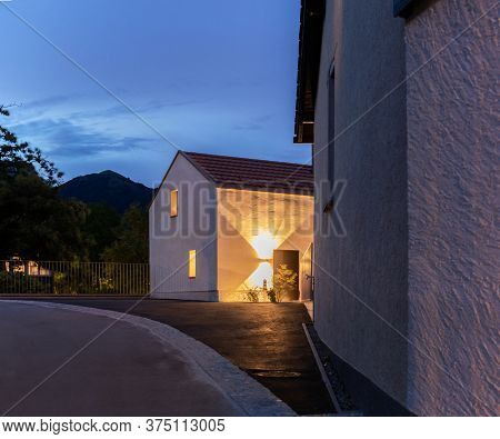 Single-family house, exterior seen in the evening. Single-family house in a small Swiss village