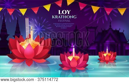Three Floating Lotus Flowers And Candles For Loy Krathong Celebrations Honouring The Goddess Of Wate