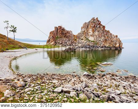 Shamanka Or Shamans Rock On Baikal Lake Near Khuzhir At Olkhon Island In Siberia, Russia. Lake Baika