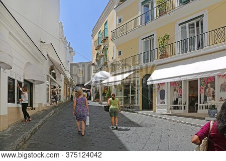 Capri, Italy - June 26, 2014: Few Tourists Walking At Street Hot Summer Day In Capri Island, Italy.