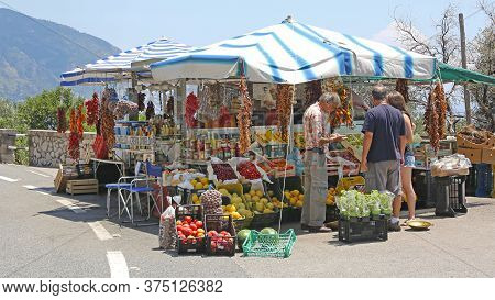 Amalfi, Italy - June 27, 2014: Roadside Stand Selling Fruits And Vegetables Produce At Amalfi Coast,