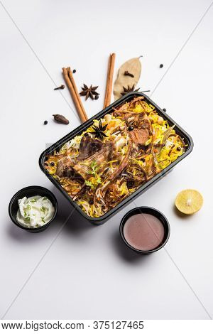 Online Food Delivery Concept  - Gosht Pulao Or Mutton Biryani Packed In Plastic Box