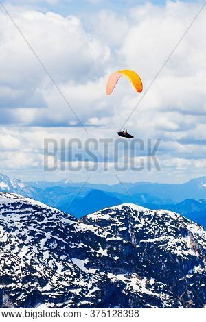 Paraglider In The Dachstein Alps Mountains In Salzkammergut Region, Austria View From Five Fingers V