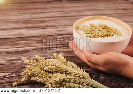 Mans Hands Holding Fresh Milled Rye Flour In White Bowl. Fresh-ground Wholemeal Bread Flour And Rye