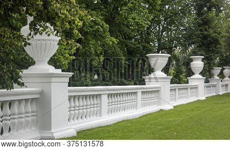 Park White Fence With Columns And Vases In The Empire Style. Minsk City, Belarus