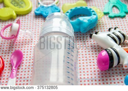 Baby Accessories On Pink Pattern Background On Table