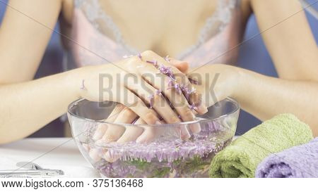 Hands Of A Woman In A Bath With Flowers. Manicure, Nail Spa. Sensuality, Skincare, Feminine, Salon,
