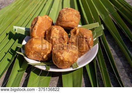 Palm Jaggery In A Plate Isolated On Apalm Leaf