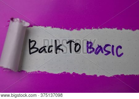 Back To Basic Text Written In Torn Paper