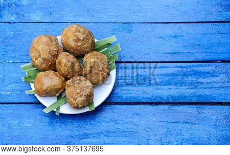 Palm Jaggery In A Plate Isolated Blue Colored Wooden Background With Copy Space For Texts Writing