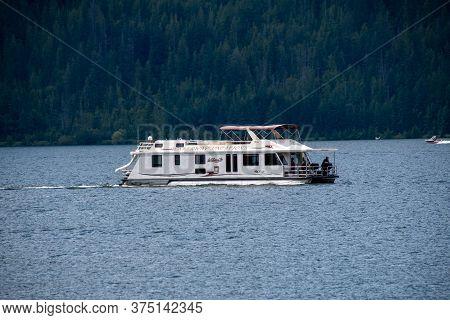 Houseboat Cruising On Mara Lake. Bc Canada  July 4th 2020