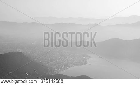 View Of Paragliders Over Pokhara City, Lake And Rolling Hills, Nepal From Sarangkot Hill, December 2