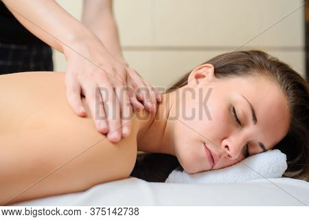 Spa Procedure Of Back Massage. Close Up View Of Beautiful Young Woman Lying On Back. Masseur /therap
