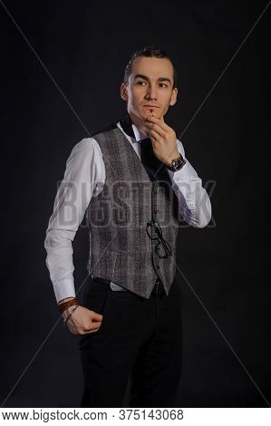 The Handsome Caucasian Young Man In A White Shirt And Suit Standing, Black Background