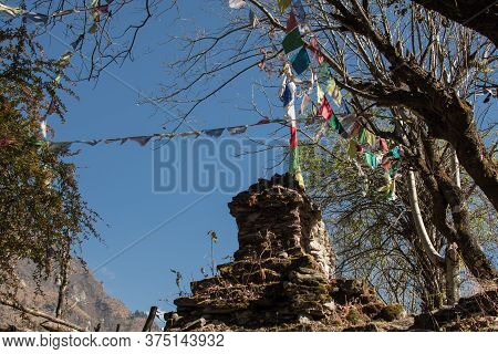 Colorful Buddhist Prayer Flags Hanging, Blowing In The Wind By The Mountains, Annapurna Circuit, Nep