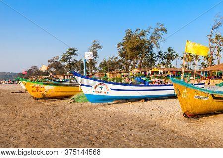 Goa, India - December 09, 2016: Fisherman Boats And Shacks On Arambol Beach In North Goa, India