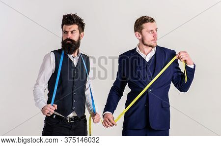 Man With Beard In Waistcoat And Young Tailor In Suit.