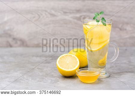 Therapeutic Drink Of Lemon, Honey And Mint In A Glass On The Table. Alternative Medicine