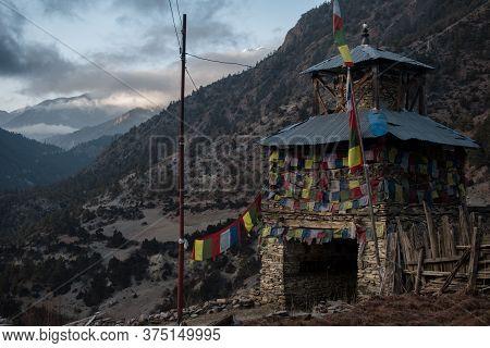 Colorful Buddhist Prayer Flags Stone Monument, Upper Pisang, Trekking Annapurna Circuit, Himalaya, N