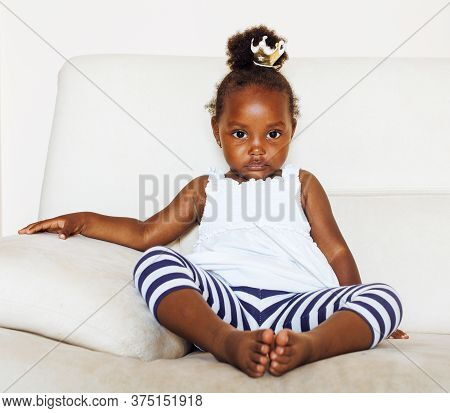 Little Cute African American Girl Playing At Home, Pretty Adorable Princess In Interior Happy Smilin