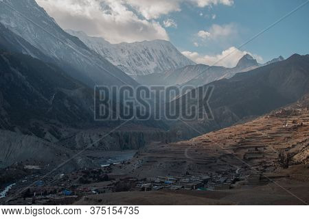 Mountain Village By Marshyangdi River And Surounding Mountains, Trekking Annapurna Circuit, Nepal, A