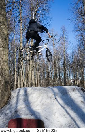 Bmx Rider Does A Dirt Jumping Trick In The Winter. Moto Whip On Bmx