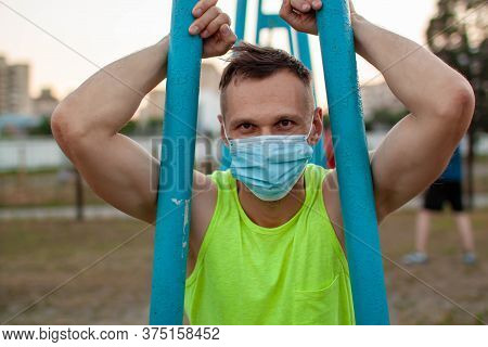 Muscular Jogger Wearing A Protective Mask During Covid-19 Quarantine.
