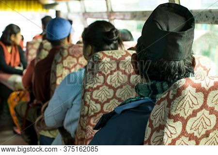 A Traditional Local Bus Towards Annapurna Circuit In Nepal Filled With Nepalese Commuting People