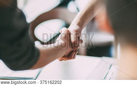 Close Up. Image Of A Business Handshake In The Office.