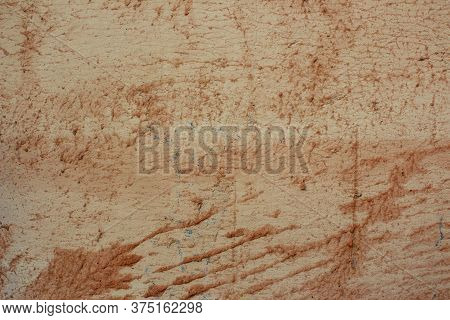 Roughly Painted Wall With Orange Paint. Beautiful Abstract Grunge Decorative Navy Orange Plaster Wal