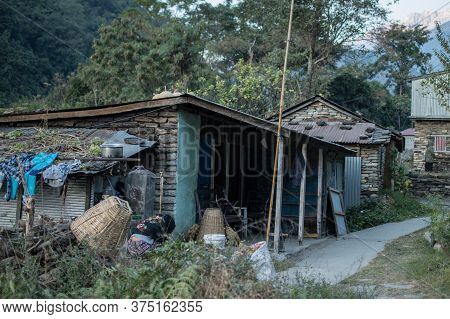 A Woman Working Outside Her Tea House In Ngadi, Nepal