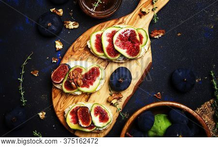 Healthy Breakfast, Crostini With Cheese, Fig And Honey, Dark Background, Top View