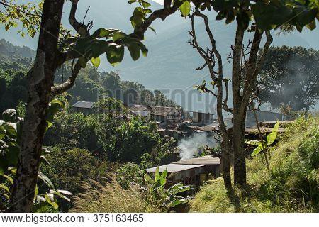 Smoke Rising From A Beautiful Mountain Village On The Hillside, Bahundanda, Annapurna Circuit, Nepal