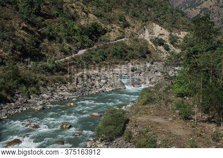 Beautiful Marshyangdi River Flowing Through The Himalayan Mountains At Annapurna Circuit, Nepal