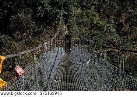 A Simple Suspension Bridge Crossing During The Annapurna Circuit In Nepal